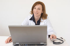 Doctor in the office Stock Images