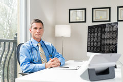 Doctor in Office. With Brain Scan Royalty Free Stock Photography