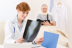 Doctor office - female physician x-ray patient. Doctor office - portrait female physician examine x-ray senior patient Stock Images