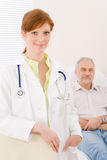 Doctor office - portrait female physician patient Stock Photo