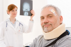 Doctor office - senior patient physician x-ray. Doctor office - senior patient female physician examine x-ray Stock Images
