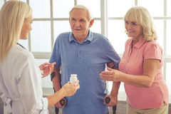 Doctor and old people Royalty Free Stock Photo