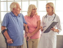 Doctor and old people Stock Image