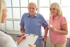 Doctor and old people Royalty Free Stock Image