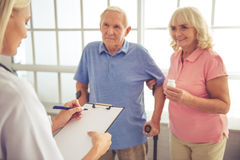 Doctor and old people Royalty Free Stock Photography