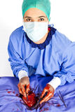 Doctor operating on patient heart. In blue with tools Royalty Free Stock Images