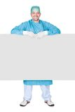 Doctor In Operation Gown Holding Blank Placard. On White Background Stock Photo