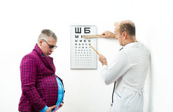 Doctor and pregnant patient Royalty Free Stock Image
