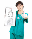 Doctor with optometry chart and thumb up Stock Photo