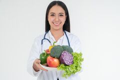 Free Doctor Or Nutritionist Holding Fresh Fruit Orange, Red And Green Apples And Smile In Clinic. Healthy Diet Concept Of Nutrition Royalty Free Stock Image - 174494806