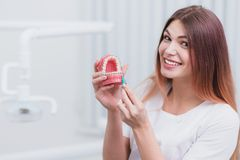Beautiful doctor orthodontist shows you how to care for your teeth. Doctor orthodontist shows you how to care for your teeth Stock Photos