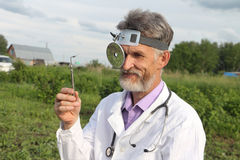Doctor otolaryngologist in rural areas Royalty Free Stock Images