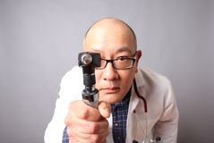 Doctor with otoscope Royalty Free Stock Photography