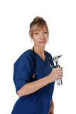Doctor with an otoscope Stock Photography