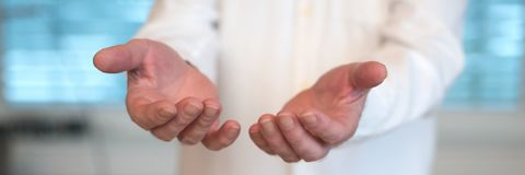 Doctor with outstretched hands to receive something. Doctor with outstretched open hands to take something Royalty Free Stock Image