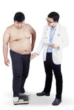 Doctor and overweight man Stock Image