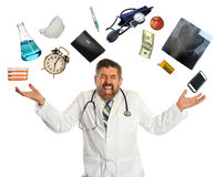 Doctor Overwhelmed by Multitasking. Isolated over white background royalty free stock photo