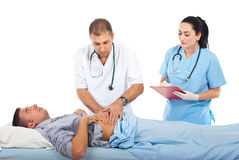 Doctor palpating patient abdomen stock photos