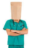 Doctor with paper bag on head Stock Images