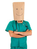 Doctor with paper bag on head Royalty Free Stock Photography