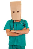 Doctor with paper bag on head Royalty Free Stock Image