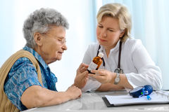 Doctor and patient. Elderly patient by a doctor