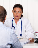 Doctor with patient. Physician in medical practice with patients. Conversation and advice of the treatment Stock Images