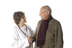Doctor and patient. Doctor greeting her patient isolated on white Royalty Free Stock Photos