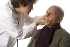 Doctor and patient. Doctor examining her patient isolated on white stock images