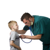 Doctor and patient. A young doctor examines a child Stock Photos