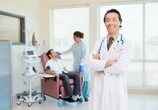 Doctor With Patient Being Examined By Heartbeat Stock Images