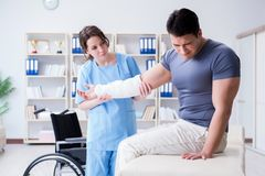 The doctor and patient during check-up for injury in hospital Royalty Free Stock Images