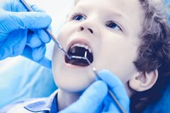 Doctor and patient child. Boy having his teeth examined with dentist. Medicine, health care and stomatology concept.  royalty free stock image