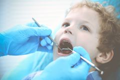 Doctor and patient child. Boy having his teeth examined with dentist. Medicine, health care and stomatology concept.  royalty free stock photography