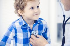 Doctor and patient child. Physician examining little boy. Regular medical visit in clinic. Medicine and health care. Concept royalty free stock images