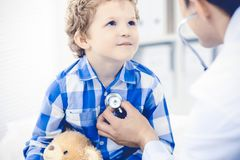 Doctor and patient child. Physician examining little boy. Regular medical visit in clinic. Medicine and health care royalty free stock images