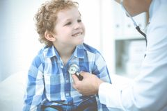 Doctor and patient child. Physician examining little boy. Regular medical visit in clinic. Medicine and health care stock image