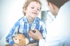 Doctor and patient child. Physician examining little boy. Regular medical visit in clinic. Medicine and health care stock images