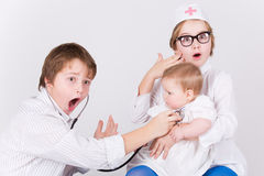 Doctor and patient, child s play Stock Photography