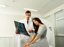 Doctor with patient at the computed tomography Stock Photos