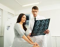 Doctor with patient at the computed tomography Stock Images