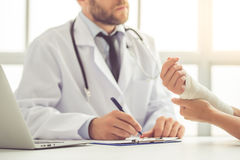 Doctor and patient Stock Images