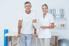 Doctor and patient with crunch looking at camera Stock Photo