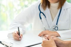Doctor and patient are discussing about health, medical diagnosis concept. royalty free stock photography
