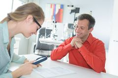 Doctor and patient discussing insurance policy. Doctor and patient are discussing insurance policy Stock Photo