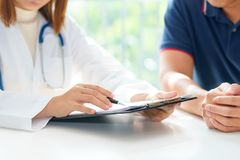 Doctor and patient are discussing something, medical diagnosis c royalty free stock photos