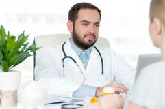 Doctor and patient discussing something stock photo
