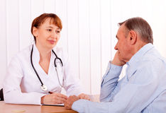 Doctor with  patient Stock Images