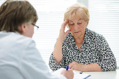 Doctor and patient. Female senior patient tells the doctor about her health complaints Royalty Free Stock Images