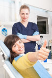 Doctor and patient giving thump up at dentist office Royalty Free Stock Image